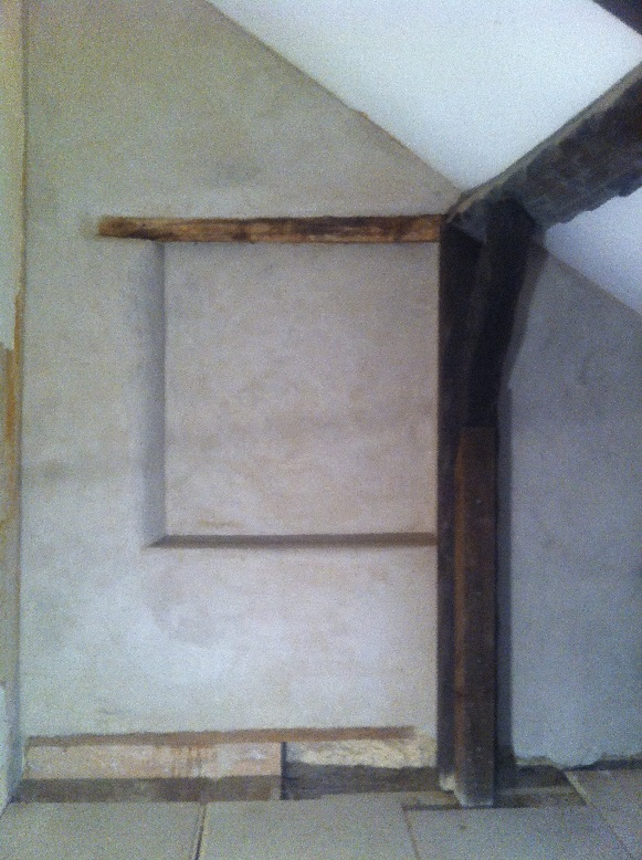 Unpainted lime plaster with false window